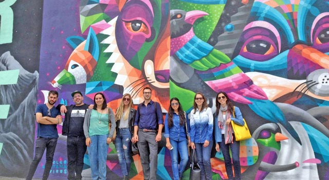Tour group in front of Eelco Virus mural