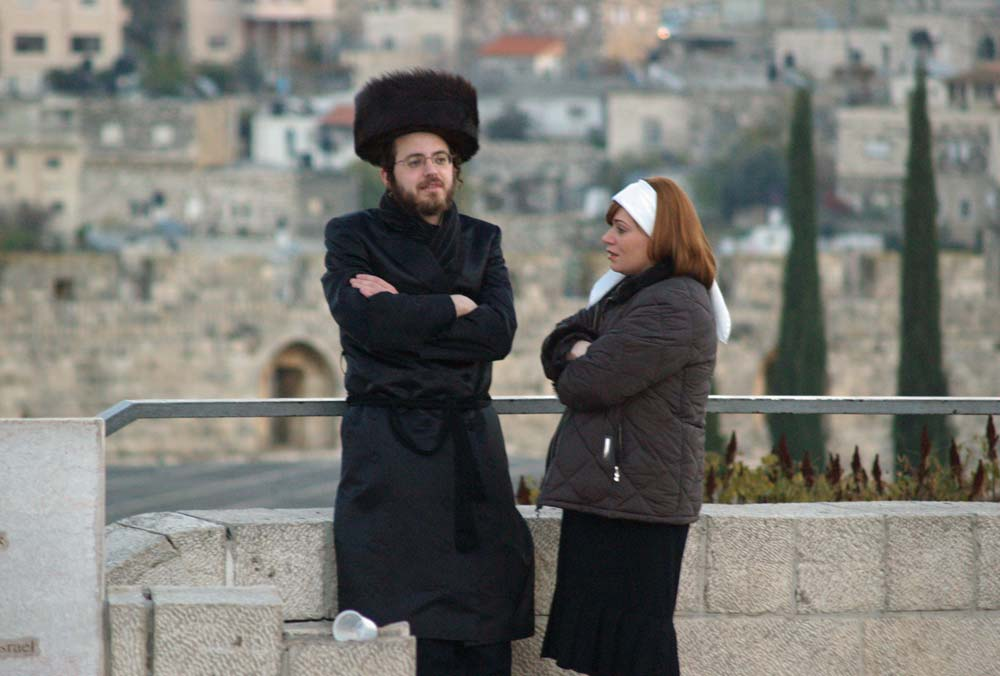 Hasidic Jewish couple standing together