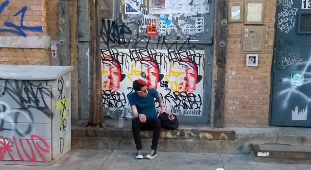 man sits on stoop in brooklyn