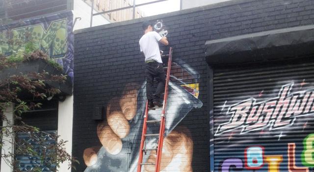 Artist Damien Mitchell painting