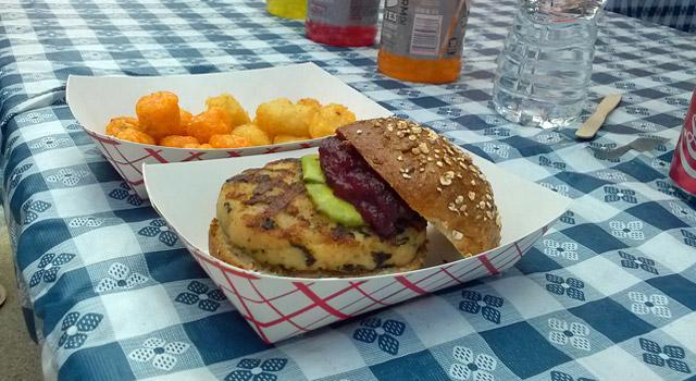 hamburger and side dish on picnic table