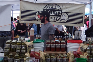 Man selling artisanal pickles at Brooklyn market