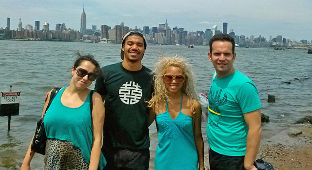 private tour group posing in front manhattan skyline view