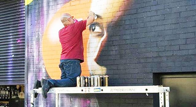 Street artist Sexer painting