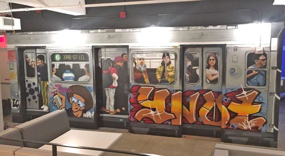 Mural of subway train inside office.